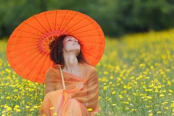 Beautiful elegant woman with an orange umbrella