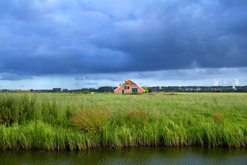 clouded sky over Dutch farmland