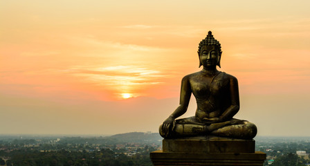 Buddha statue on sunset at Ayutthaya, Thailand