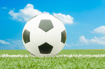 Soccer ball on the field with blue sky.