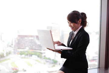Young business woman using computer