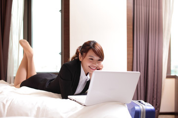 business woman with notebook lying in hotel