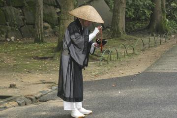 Monk Begging and Meditating