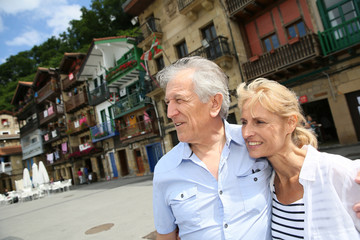 Senior couple visiting northern spanish town