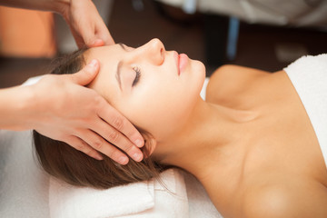 Woman having a facial massage