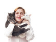 woman veterinarian holding two cats