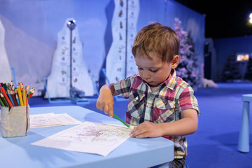 Child drawing in playroom