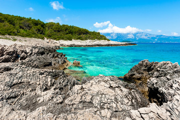 Rocky shore with turquoise sea water. Adriatic coast of Korcula