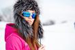 Happy young caucasian woman wearing ski goggles