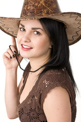 A beautiful woman in a cowboy hat.