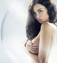 Conceptual photo of the brunette beautie closed in the glass bal