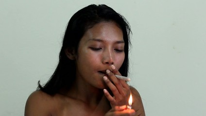 woman refuses to smoke a marijuana cigarette