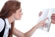 canvas print picture - Frau sieht schlecht und kneift Augen beim Lesen zusammen