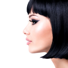 Beautiful brunette woman with short hairstyle.