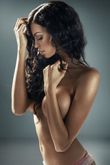 Sensual young woman with long dark hair