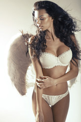 Relaxed woman angel with perfect tawny complexion