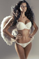 Conceptual photo of attractive woman angel