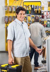 Male Customer Purchasing Tools At Shop