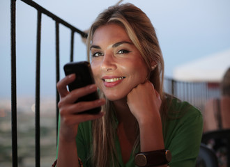 happy woman who receives good news by message