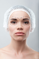 Beautiful young woman in surgical hat with perforation lines on