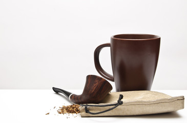 pipe tobacco and a glass background