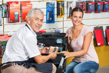 Salesman Assisting Woman In Hardware Store