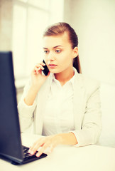 businesswoman with smartphone in office