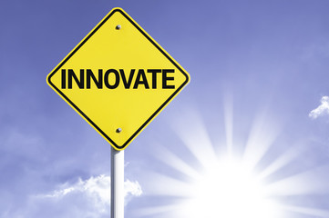 Innovate road sign with sun background