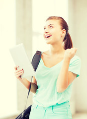 happy student girl with tablet pc