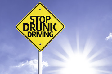 Stop Drunk Driving road sign with sun background
