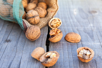 Open walnuts in sack