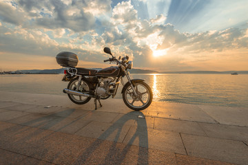 Beautiful sea sunset with motorbike on beach, Marmara sea
