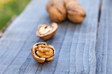 Open walnuts on wooden table