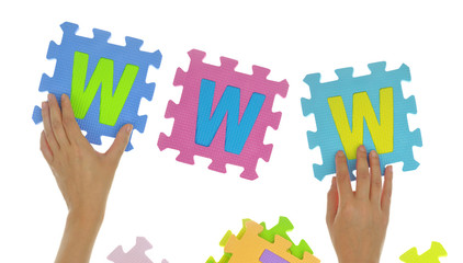 "Hands forming words ""Thank you"" with jigsaw puzzle pieces"