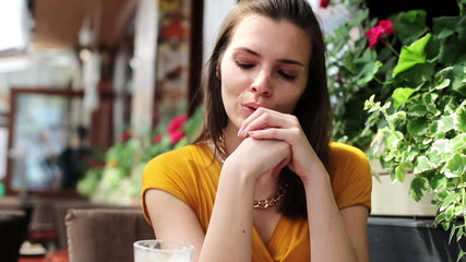 Portrait of beautiful sad, serious woman in restaurant
