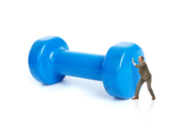 Businessman and blue dumbbells