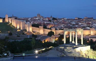 City walls of Avila at dusk. Castile and Leon, Spain