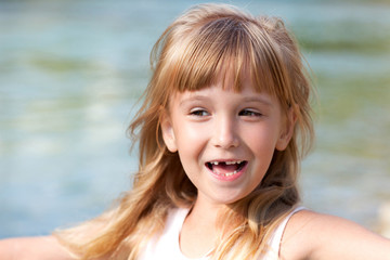 Smiling little girl without tooth