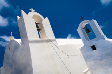 Fragment of the church with a bell tower in Santorini