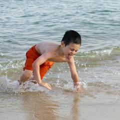 Child in sea on beach