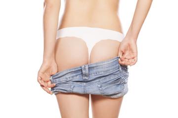 woman dresses her short jeans pants