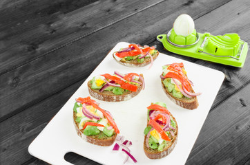 Brown bread with avocado, smoked salmon, boiled egg