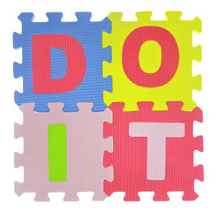"Phrase ""Do it"" made with jigsaw puzzle pieces isolated"
