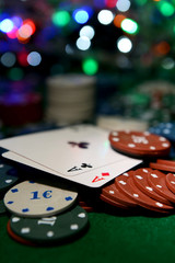 Cards and chips for poker on shiny background