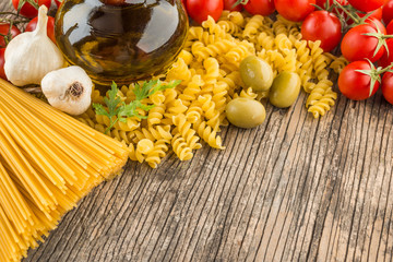 Italian food ingredients wooden background