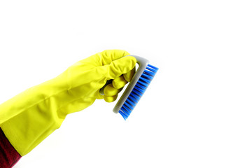 Hand with blue cleaning brush