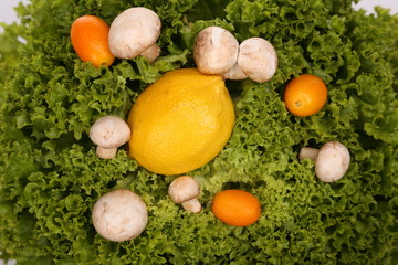 Green salad with lemon, tangerines and mushrooms