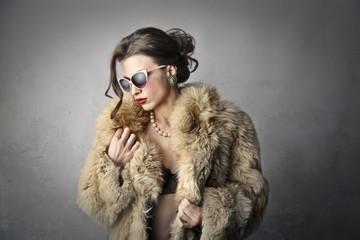 beautiful rich woman who is wearing a fur