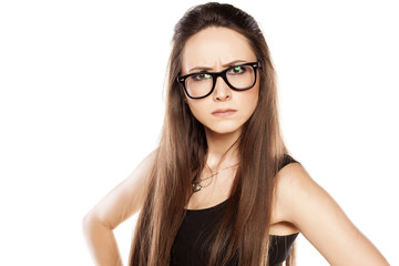 angry young woman with glasses on white background