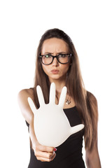woman is holding an inflated rubber glove in the stop position